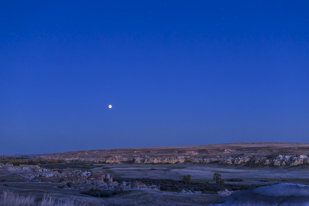 Dyer-Eclipsed Moon over Writing on Stone