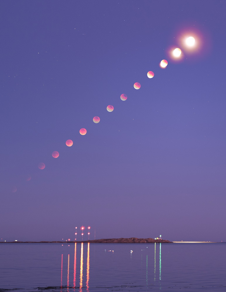 Also view the eclipse from Victoria, British Columbia, was John McDonald. He set up his camera at clover Point and recorded this sequence of the eclipsed Moon rising over Trial Island in Haro Straight.